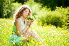 Happiness young woman in field of flowers Royalty Free Stock Images