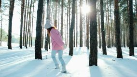 Happiness, young woman flirting, looking into the camera, sun`s rays shine through trees in backlight, beautiful, happy. Girl runs between trees in the woods stock footage