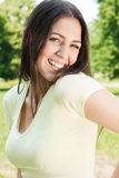Happiness young woman in park Royalty Free Stock Images
