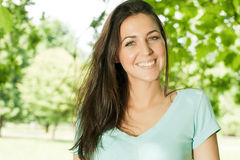 Happiness young woman in park. Portrait of happiness young woman in park Stock Images