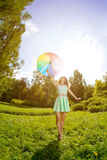 Happiness young woman with rainbow umbrella Stock Photo