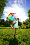 Happiness young woman with rainbow umbrella Royalty Free Stock Photo