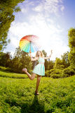 Happiness young woman with rainbow umbrella Royalty Free Stock Images