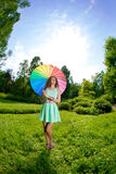 Happiness young woman with rainbow umbrella Royalty Free Stock Image