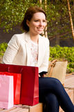 Happiness. A young woman sitting on a benchexcited about meeting someone Stock Photos