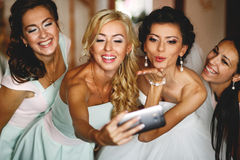 The happinest bride with bridesmaids Stock Image