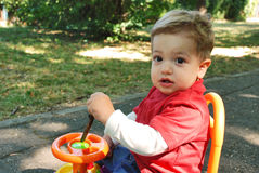 Happly little boy. Portrait with gorgeous little boy playing in the park Stock Images