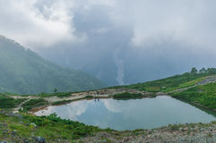 Happo-ike Pond at Happo-one in Hakuba, Nagano,. Shirouma mountains and Happo-ike Pond at Happo-one in Hakuba, Nagano,Japan Stock Photos