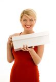 Happy. Girl in red dress with blank box Stock Photo