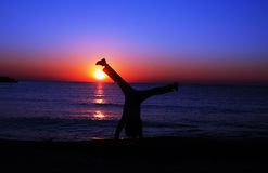 Happy. Silhouette stand in hands on beach Royalty Free Stock Photography