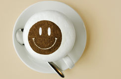 Happy. Smiley face shaped with chocolate onto latte or cappucino coffee. horizontal version Stock Photo