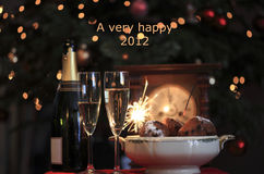 Happy 2012. Happy new year 2012! New year design of a typical new Year's eve in the netherlands with champagne, sparkles and oliebollen Royalty Free Stock Image
