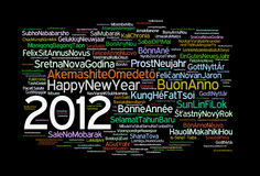 Happy 2012. The phrase Happy New Year in different languages with the more widely spoken in bigger fonts and the year 2012 within the text, in black background stock illustration