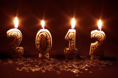 Happy 2012 - candles burning Stock Photo