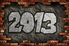 Happy 2013. Symbol of new year on a wall Stock Images