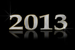 Happy 2013. 2013 written in letters looking like metal on a black background with partial reflection Stock Photography