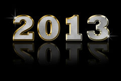 Happy 2013. 2013 written in metal on a black background with a reflections of 2012 Stock Photo