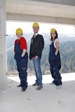 Happy. Three happy workers posing and smiling Royalty Free Stock Images