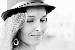 Happy. The girl in the hat smiles modestly Royalty Free Stock Photography