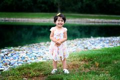 Happy. A happy toddler smiling by a lake in michigan Stock Images