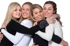 Happy 4 woman hug Royalty Free Stock Image