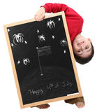 Happy 4th of July Boy with Clipping Path. Adorable six year old school boy with Happy 4th of July message on chalkboard with clipping path over white stock image