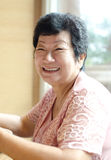 Happy 60s Senior Asian Woman Royalty Free Stock Image