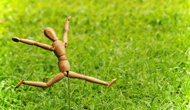 Happy. Concept no stress and relax artist model jumping over green grass background Stock Image