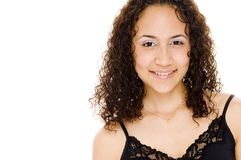 Happy. A smiling young woman in lacy black top on white background Royalty Free Stock Photography