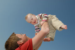 Happy. Baby in front of the sky Royalty Free Stock Images
