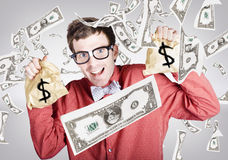 Happy accountant man in rain of falling money Stock Images