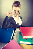 Happy accountant with piles of binders. Stock Photo