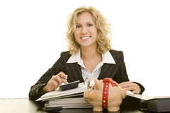 Happy Accounting. Blonde business woman sitting at her desk and calculating stock photo