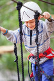 Happy active boy in rope park Royalty Free Stock Photos