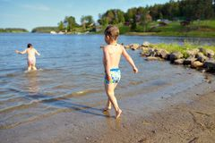 Happy active child boy and girl having fun on beach Royalty Free Stock Photography