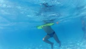 Happy active child in the swimming pool. Underwater view stock footage