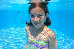Happy active child swims underwater in pool Royalty Free Stock Photography