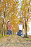 Happy active children jumping Stock Images