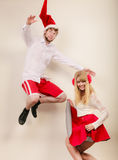 Happy active couple dancing and jumping. Royalty Free Stock Images