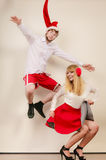 Happy active couple dancing and jumping. Stock Image