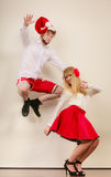 Happy active couple dancing and jumping. Stock Photography