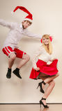 Happy active couple dancing and jumping. Stock Images