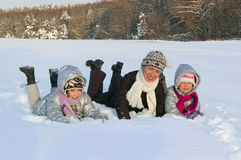 Happy active family having fun on winter. Royalty Free Stock Photo