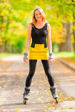 Happy active girl plays sports in park Royalty Free Stock Image