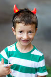 Happy active little boy with horns Royalty Free Stock Photo