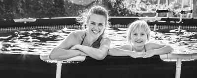 Happy active mother and child in swimming pool relaxing Royalty Free Stock Photography