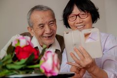 Senior Couple Using Smartphone at home. stock photo