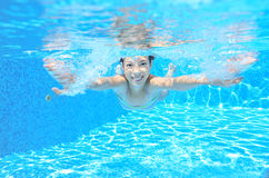 Happy active underwater child swims in pool Stock Photography