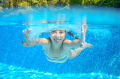 Happy active underwater child swims in pool Royalty Free Stock Photo