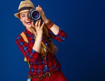 Happy active woman hiker with modern DSLR camera taking photo Stock Image